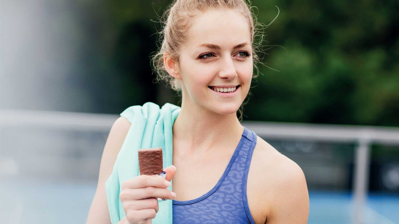 Woman holding bar after workout