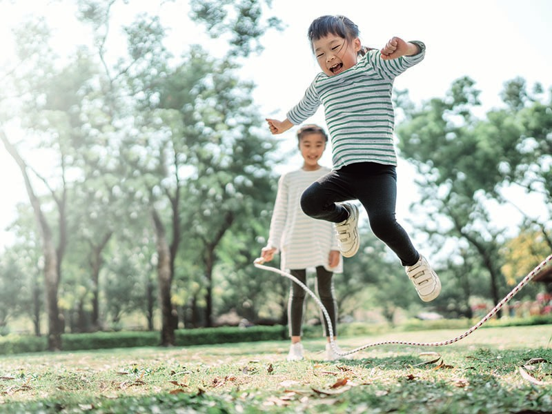 Consumer Powders - Two young girls with jump rope in park