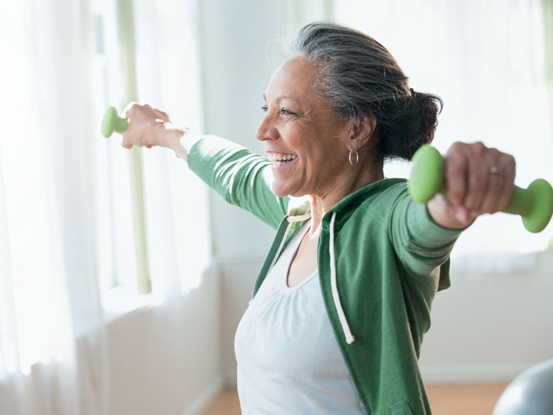 Consumer Powders - Older women exercising at home with weights