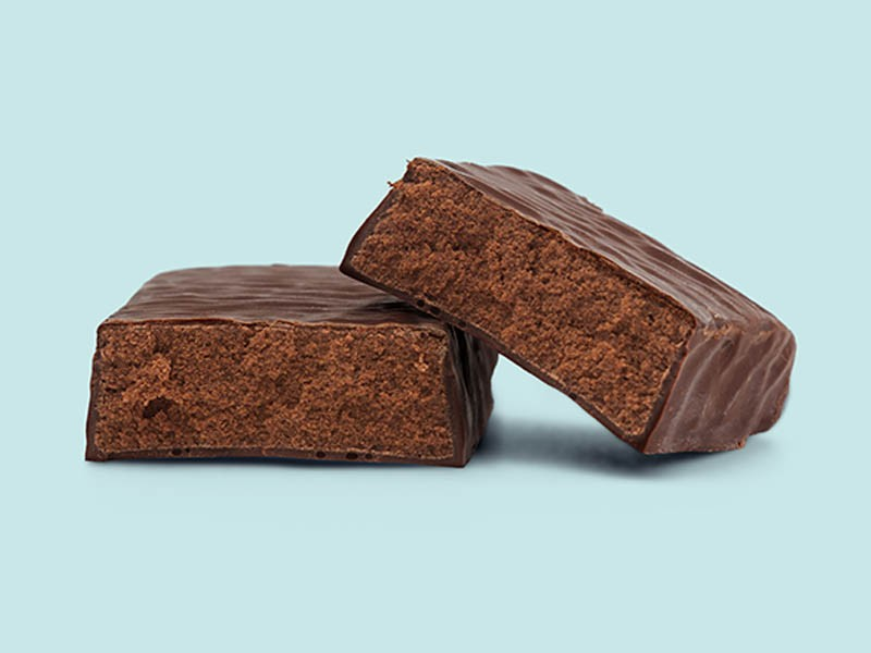Brown coated dough bar on a blue background