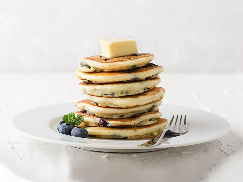 Blueberry pancakes with on white holiday party table